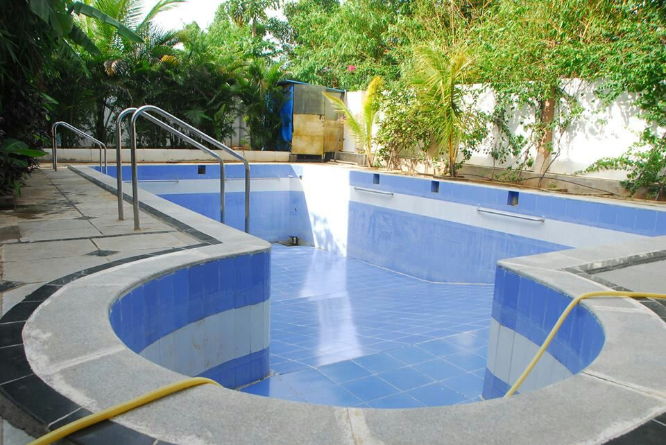 Blooming patch farm house resorts a family resort - Swimming pool construction cost in hyderabad ...